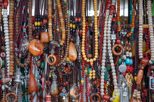 Colorful necklaces made of stones and beads Wallpaper Mural