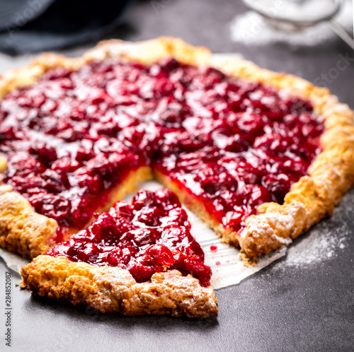 Foto auf Leinwand Kirschblüte Bakery products. Summer pie with berries. Galeta with cherry sprinkled with powdered sugar.
