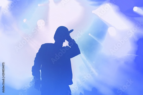 Young hip hop singer on stage in music hall Wallpaper Mural