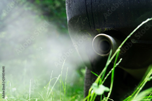 Fotografie, Tablou  Exhaust gases from the muffler of the car