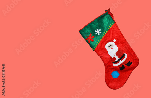 Cute Christmas stocking isolated on pink or coral background Poster Mural XXL