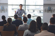 Young male professionals speaks at a business seminar