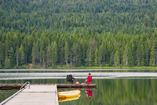 Original Photograph Of Two People Fishing Off A Dock On A Reflective Lake
