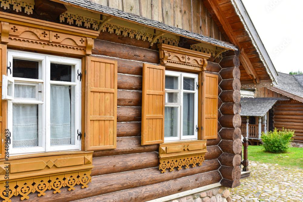 Fototapeta Russian national manor made of natural logs