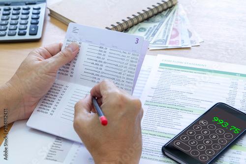 Fotomural Reviewing bank passbook saving account balance and cash flow statement analysis