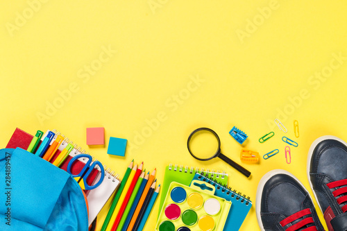 Photo sur Toile Pays d Asie School backpack with stationery on yellow background.