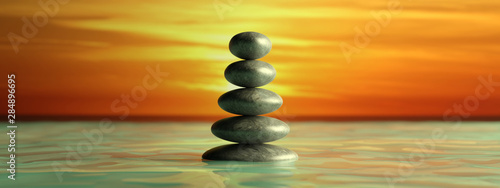 Zen stones row from large to small  in water with blue sky. 3d illustration - 284896695