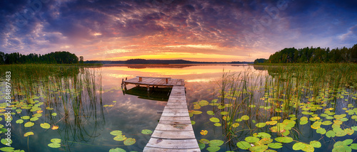 Tuinposter Waterlelies Beautiful summer sunrise over lake - Panorama