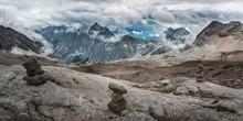 Stones Cairn Bridging On Zugspitze Peak, Alps, Germany