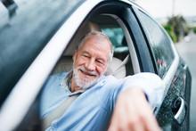 Happy Senior Man Sitting In Ca...