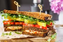 Vegan Sandwich With Tofu, Hummus, Avocado, Tomato And Sprouts.