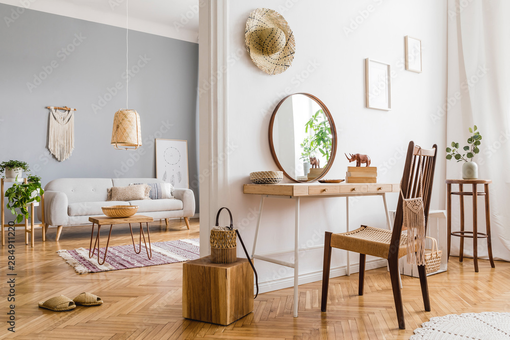 Fototapety, obrazy: Modern and design home interior of open space with wooden desk, coffee table, sofa, chair, plants, mirror, macrame and elegant accessories. Stylish and minimalistic home decor. Template. Bright rooms.