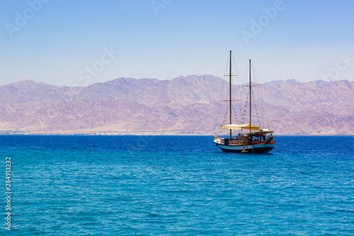 Vászonkép  cruise tourism on a sea summer season scenic landscape picture of vintage wooden