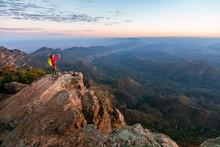 A Woman Is Standing On St Mary Peak Taking A Photo At Dawn, The Highest Point In The Flinders Ranges National Park, South Australia