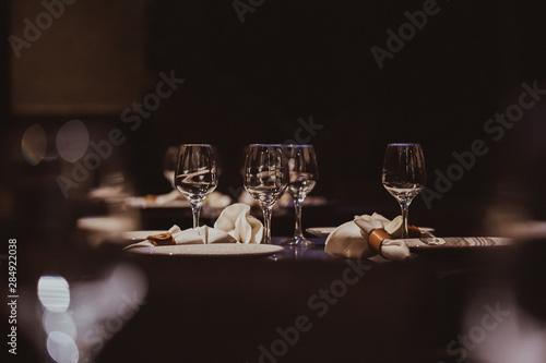 Obraz Empty glasses set in restaurant - fototapety do salonu