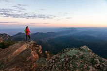 A Woman Is Standing On St Mary Peak At Dawn, The Highest Point In The Flinders Ranges National Park, South Australia