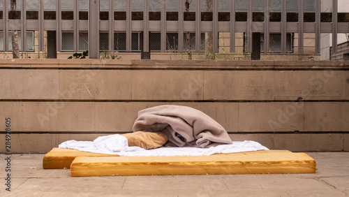 homeless area bed mattress bed on street barcelona spain refugee Canvas Print
