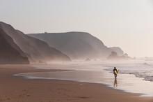 Portugal, Surfer Walking On Be...