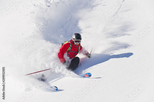 Austria, Zuers, Young man doing telemark skiing on Arlberg mountain