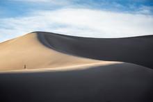 Woman Hiking On Sand Dunes