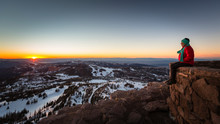 A Woman Sitting On A Wall At Forest Service Lookout At The Summit Of Brian Head, Utah.