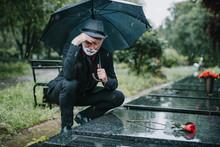 Elegant Sad Elderly Man Standi...