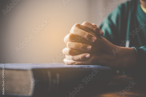 Foto hands woman laying on the biblical while praying for christian religion blessing
