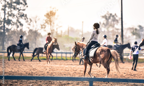 young girl is training to ride a horse horse is in the practice field