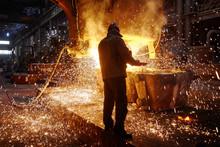 Steelmaker At Ingot Casting. E...