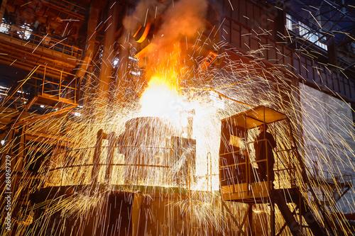 Photo Metallurgy. Casting ingot. Electric arc furnace shop.