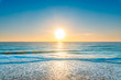 canvas print picture - The ocean under the blue sky and the sunset in the evening