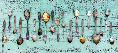Fototapeta Vintage cutlery - spoons, forks and knives on an old wooden background. obraz