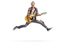 Young Male Musician Playing An Electric Guitar And Jumping