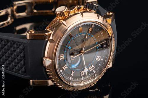 Fotografía  close up view of nice man's wrist watch on black background