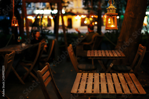 Foto Restaurants and bars on evening streets