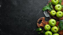Fresh Green Apples With Green Leaves On A Black Background. Fruits. Top View. Free Space For Text.