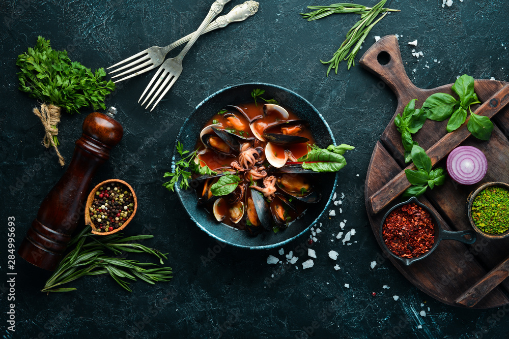 Fototapety, obrazy: Tomato soup with seafood. Mussels, clams and octopuses. In the old background. Top view. Free copy space.