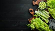 Fresh Green Celery Stalk On A Black Background. Healthy Food. Top View. Free Space For Your Text.