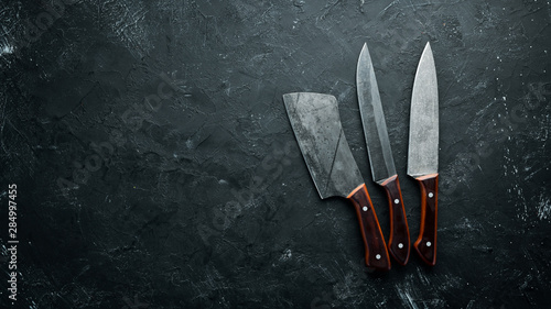 Kitchen old knife on a black stone table Fototapet
