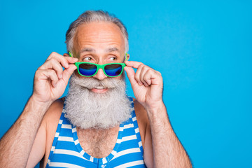Close-up portrait of his he nice attractive funky cheerful cheery content gray-haired man spending leisure cool carefree life lifestyle isolated over bright vivid shine turquoise blue background