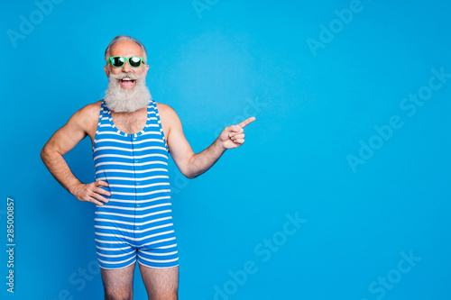 Fototapeta Portrait of his he nice attractive content funky excited positive cheerful cheery gray-haired man showing advice ad advert solution isolated over bright vivid shine turquoise blue background obraz