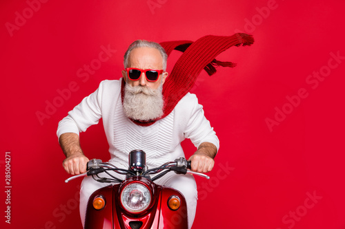 Fototapeta  Close up photo of cool pensioner riding his bike with air wind blowing wearing w