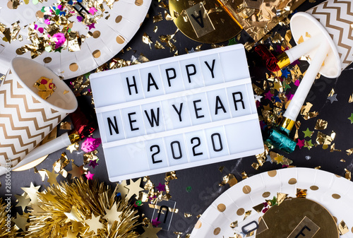 Fotomural  Happy new year 2020 on light box with party cup,party blower,tinsel,confetti