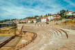 Ohrid. Macedonia amphitheater with houses on background