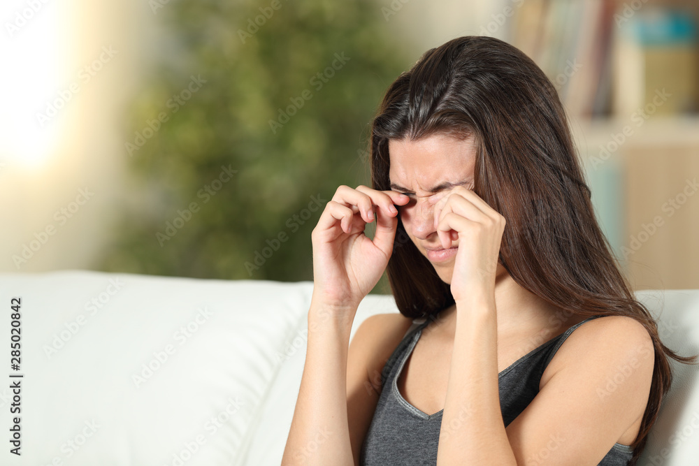 Fototapeta Girl suffering itching scratching eyes at home