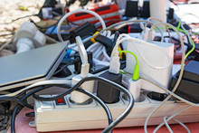 A Bunch Of Charging Gadgets, Electronic Devices, Messy Wires. .dependence On Electricity