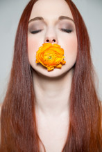 Beautiful Young Girl With Yellow Rose In Her Mouth