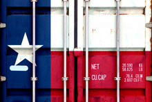 The National Flag Of The US State Texas In A Container Doors On The Day Of Independence In Different Colors Of Blue Red And Yellow. Political And Religious Disputes, Customs And Delivery.