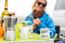 Woman Camping Travelling With Breakfast Mug And Happy Camper Text.