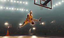 Basketball Player Scoring A Slam Dunk Basket. Floodlit Basketball Court